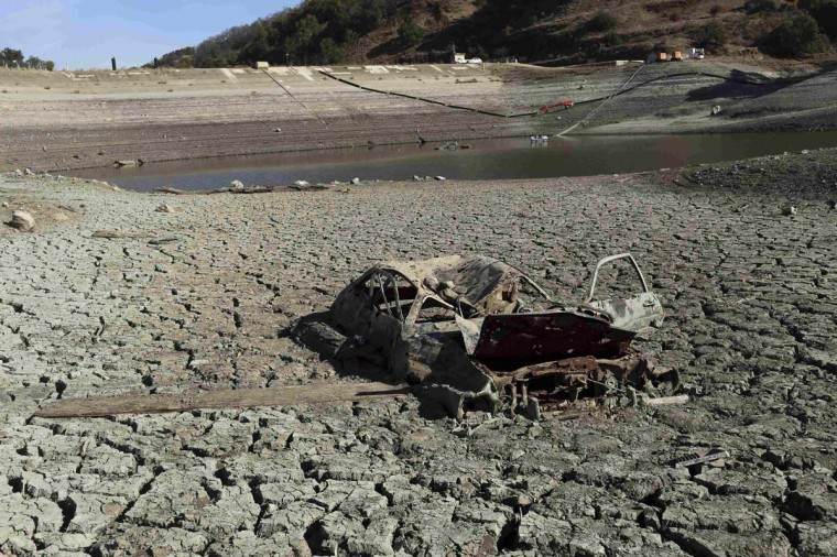 The remains of an automobile is pictured on the bottom of the Almaden Reservoir near San Jose, California. (Robert Galbraith/Reuters photo)