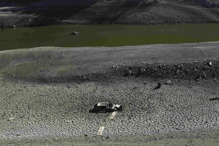 The remains of an automobile is pictured on the nearly dry bottom of the Almaden Reservoir near San Jose, California. (Robert Galbraith/Reuters photo)