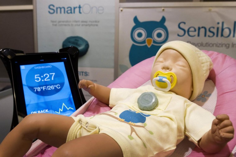 A SmartOne infant sleep monitor is shown on a doll at the Sensible Baby booth during the 2014 International Consumer Electronics Show (CES) in Las Vegas, Nevada. The wearable device, fits into a chest pocket, and sends information and active alerts on temperature, baby orientation and breathing to a parent's mobile device. The device will retail for $149.00 and be available online in the second quarter of 2014. (Steve Marcus/Reuters photo)