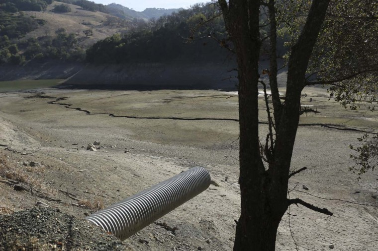 A water pipe that normally carries water is shown above the nearly dry Almaden Reservoir near San Jose, California. (Robert Galbraith/Reuters photo)