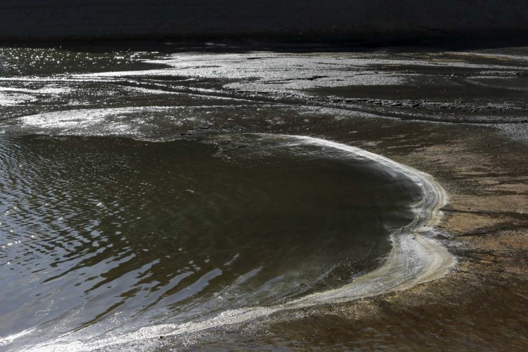 Water pools at the bottom of the Almaden Reservoir near San Jose, California. (Robert Galbraith/Reuters photo)