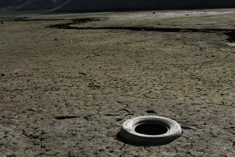 An automobile tire is shown at the bottom of the Almaden Reservoir near San Jose, California January 21, 2014. (Robert Galbraith/Reuters photo)