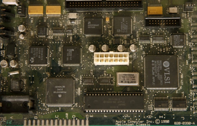 "The motherboard of the Apple Macintosh Classic is seen during the ""History of Computers"" exhibition in Sarajevo on Nov. 30, 2013. 110 computers from the 1970s to 2008 are displayed during the exhibition, ahead of the opening of the Sarajevo museum of old computers. (REUTERS/Dado Ruvic)"