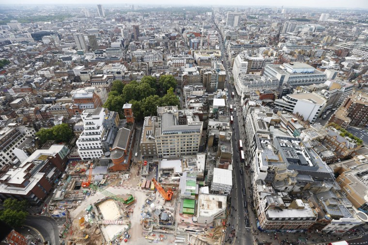 Work on the new Crossrail and London Underground station at Tottenham Court Road continues as traffic moves down Oxford Street in central London on September 30, 2013. (REUTERS/Andrew Winning)