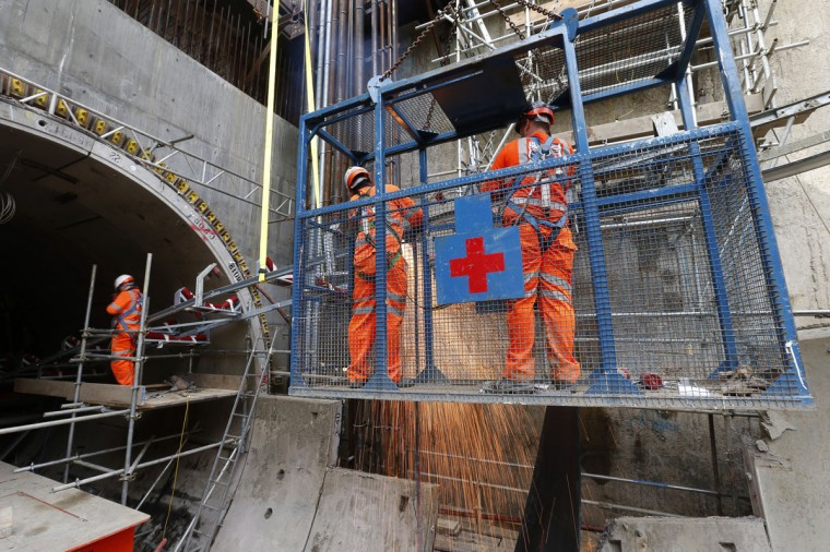 A worker uses a blow torch on part of a conveyor at Crossrail's Stepney site in east London on September 25, 2013. (REUTERS/Andrew Winning)