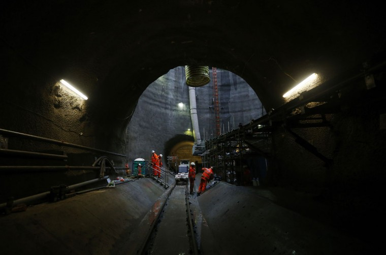 Workers stand in the mouth of one of the tunnels at Crossrail's Limmo Peninsula site in east London on December 14, 2012. (REUTERS/Andrew Winning)