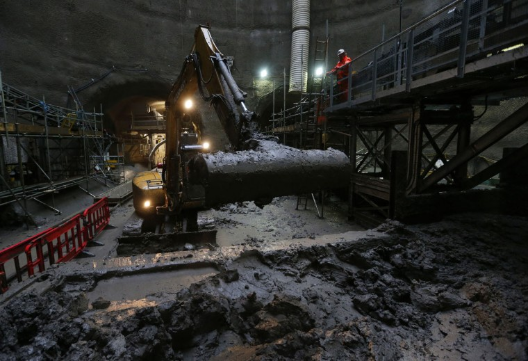 A worker operates a mechanical digger 40 meters underground in the access excavation at the mouth of the tunnel at Crossrail's Limmo Peninsula site in east London on December 14, 2012. (REUTERS/Andrew Winning)