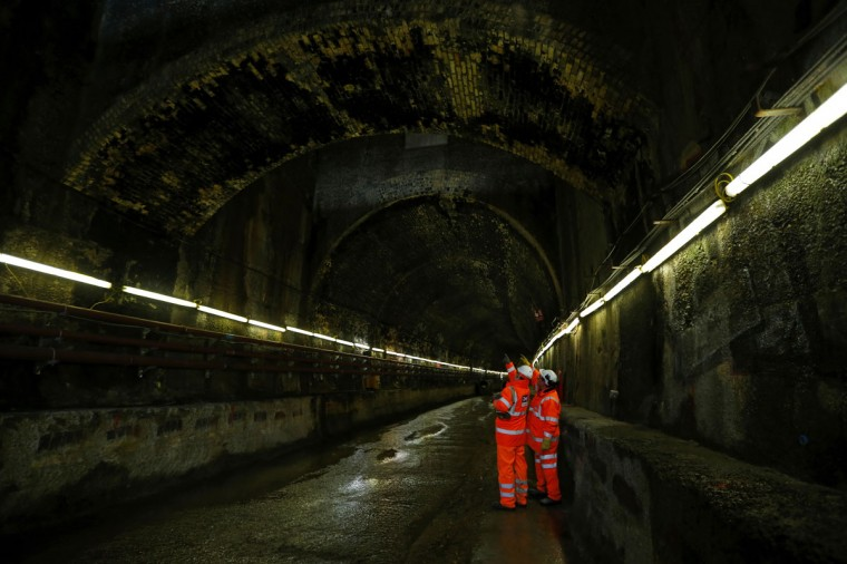 Workers stand inside a Victorian-era tunnel that is being reconditioned at Crossrail's Albert Dock site in east London on March 13, 2013. (REUTERS/Andrew Winning)