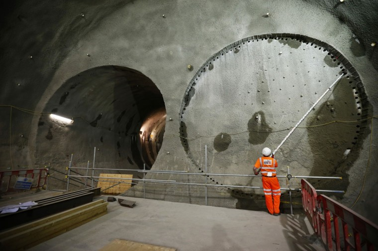 A worker surveys a tunnel entrance at Crossrail's Stepney site in east London on September 25, 2013. (REUTERS/Andrew Winning)