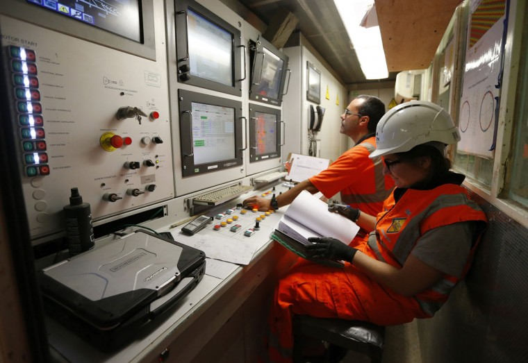 Engineers work in the tunnel-boring machine creating the Crossrail tunnel being built from Paddington towards Farringdon under central London on March 13, 2013. (REUTERS/Andrew Winning)