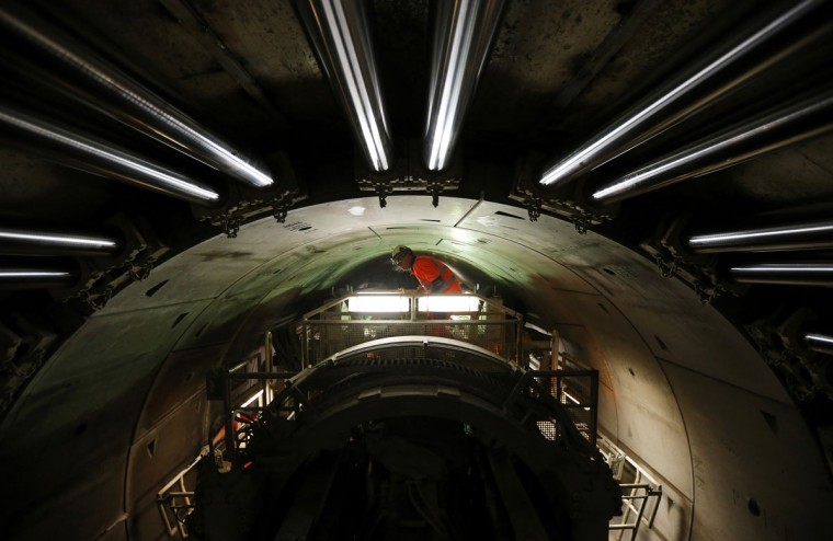 A worker stands on the tunnel-boring machine creating the Crossrail tunnel being built from Paddington towards Farringdon under central London on March 13, 2013. (REUTERS/Andrew Winning)