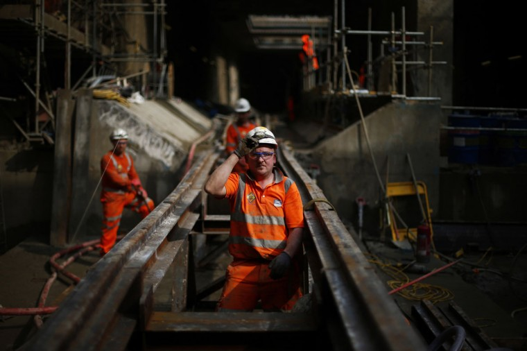 Workers line up rails for the tunnelling machine at Crossrail's Stepney site in east London on September 25, 2013. (REUTERS/Andrew Winning)