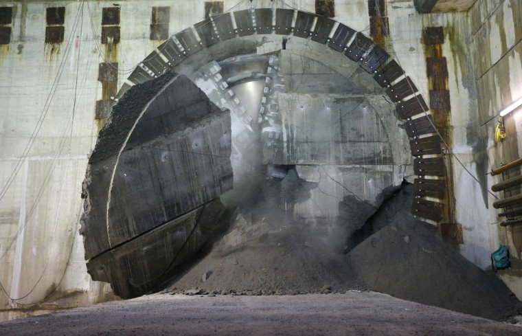 Concrete shatters as a tunnelling machine makes the breakthrough into the station structure at Canary Wharf in east London on June 11, 2013. (REUTERS/Andrew Winning)