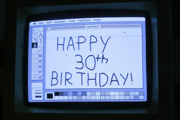 "Curator Adam Rosen writes ""Happy 30th Birthday"" using version 1 of MacPaint on an original 128K Macintosh computer at the Vintage Mac Museum in Malden, Mass. (REUTERS/Brian Snyder)"