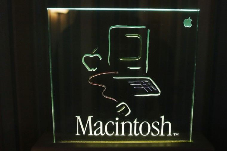 The logo for the original 128K Macintosh computer is displayed at the Vintage Mac Museum in Malden, Mass. (REUTERS/Brian Snyder)