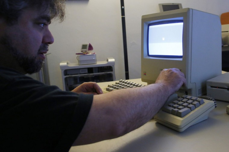 Curator Adam Rosen boots on an original 128K Macintosh computer at the Vintage Mac Museum in Malden, Mass. (REUTERS/Brian Snyder)