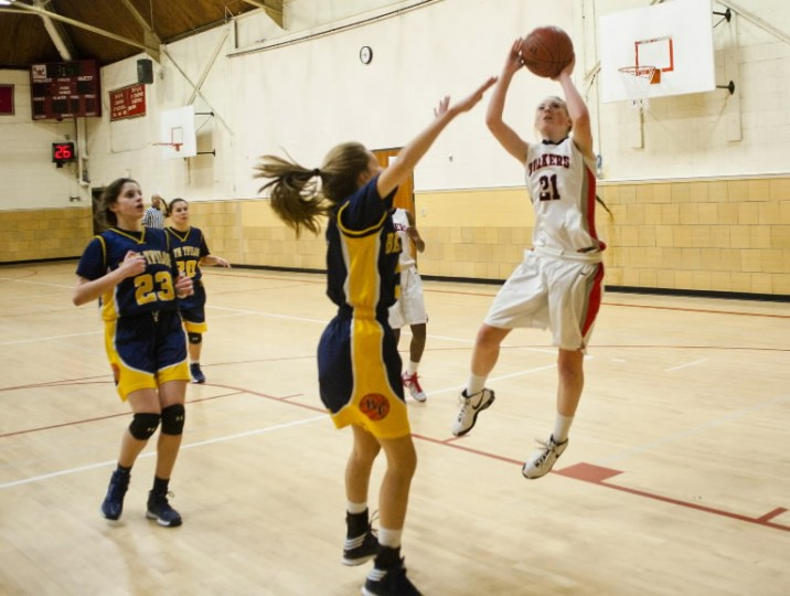 Friends School's Rachel Kehoe takes a leaping shot over Beth Tfiloh's Aly Chason during a girls basketball game on Wednesday, Jan. 29. (Photo by Noah Scialom/BSMG)