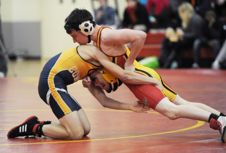 Calvert Hall's Nick Fink, right, tries to escape the grip of Catonsville's MIke Thome in the 106 weight class during a wrestling match at Calvert Hall College in Towson on Tuesday, Jan. 28, 2014. (Photo by Jon Sham/BSMG)