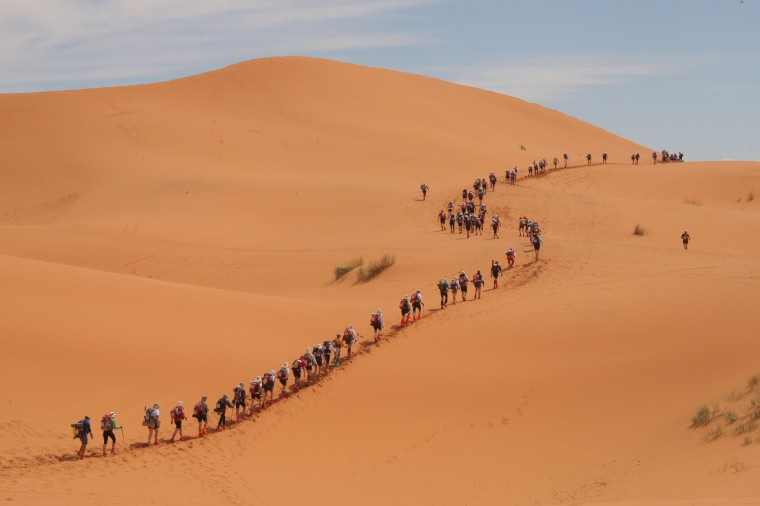 A long file of competitors take the start of the 24th Marathon des Sables in the Sahara desert, on March 30, 2009 climbing the first dunes of Merzouga, some 300 kilometers south of Ouarzazate in Morocco. (PIERRE VERDY/AFP/Getty Images)