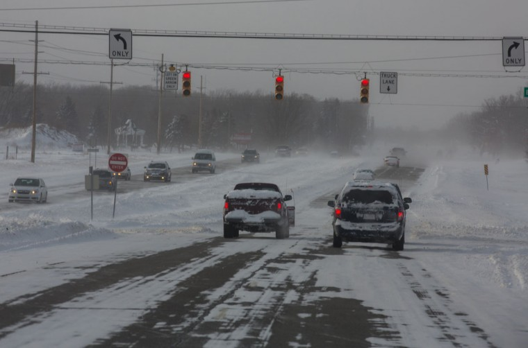 Vehicles endure poor driving conditions along Lincoln Highway (U.S. 30) in Merrillville, Ind. on Monday, Jan. 6, 2014. (Zbigniew Bzdak/Chicago Tribune)