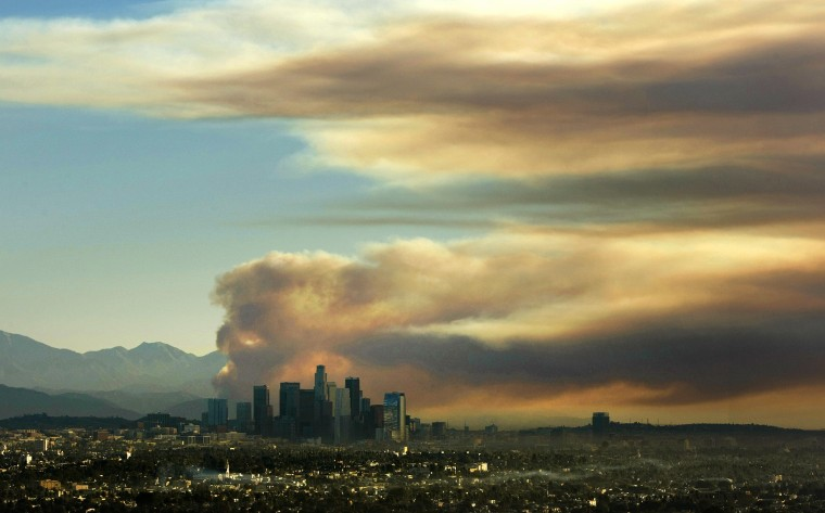 A large fire plume rises above the downtown skyline from the fast-growing Colby fire from the Baldwin Hills Scenic Overlook Thursday morning, January 16, 2014. (Al Seib / Los Angeles Times)
