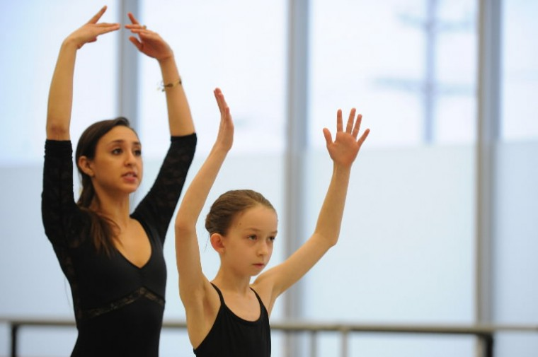Ten-year old Lidia Bridges of Towson, who has been taking dance for five years, looks to mimic the moves of herballet instructor Analiese Umana during a Towson University Community Dance ballet class at the Center for the Arts studio on Saturday, Jan 11. (Photo by Brian Krista/BSMG)