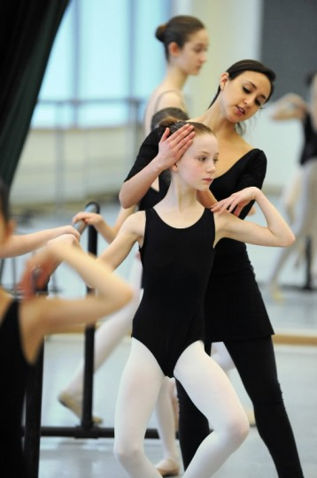 Ballet instructor Analiese Umana helps Anabel Saba, 11, of Homeland, with proper head position and posture during a Towson University Community Dance ballet class at the Center for the Arts studio on Saturday, Jan 11. (Photo by Brian Krista/BSMG)