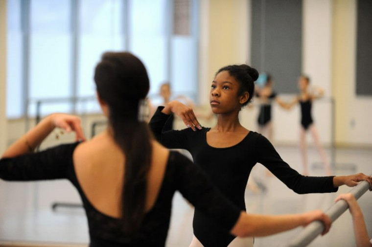 Madison Platt, 12, of Randallstown rehearses ballet positions on the barre during a Towson University Community Dance class at the Center for the Arts studio on Saturday, Jan 11. (Photo by Brian Krista/BSMG)
