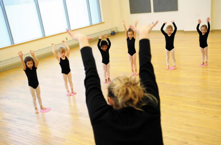 Young dance students imitate the moves of their instructor, Candice Webster, Director of Education for Towson University Community Dance, during a class at the Center for the Arts studio on Saturday, Jan 11. (Photo by Brian Krista/BSMG)