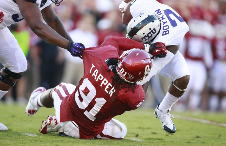 No. 2: Charles Tapper College: Oklahoma Position: Defensive end Year: Sophomore High school: City Hometown: Baltimore 2013 recap: Tapper, who played parts of just two seasons of high school football at City, was selected to the All-Big 12 first-team defense – the only sophomore on the squad. The former Knights basketball star finished the regular season with 47 tackles (22 solo), nine tackles for loss and 5.5 sacks. Tapper helped the Sooners to an 11-2 record and a 45-31 win over Alabama in the Sugar Bowl. Photo credit: Trevone Boykin/USA Today Sports