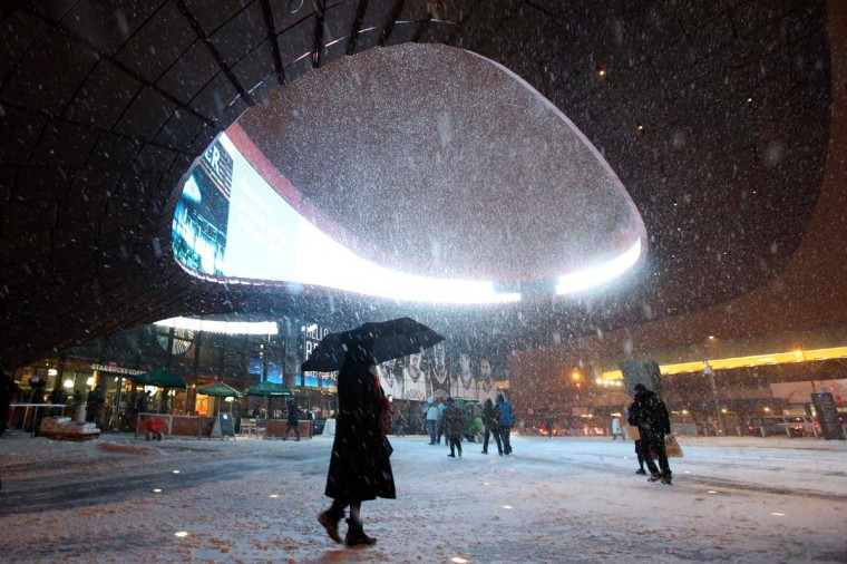 A pedestrian walks in the snow in front of the Barclays Center before the start of a game between the Brooklyn Nets and the Orlando Magic at Barclays Center. (Brad Penner/USA TODAY Sports)