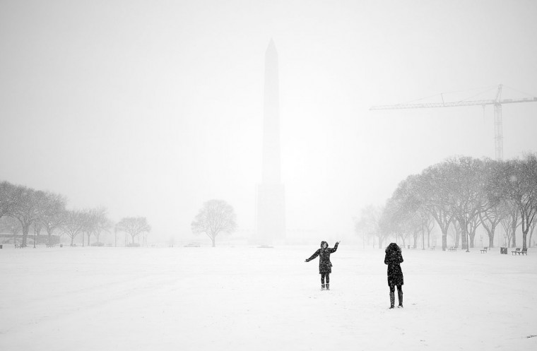 Tuesday's snowfall in Washington obscures the Washington Monument on the National Mall. (For The Washington Post by Astrid Riecken)