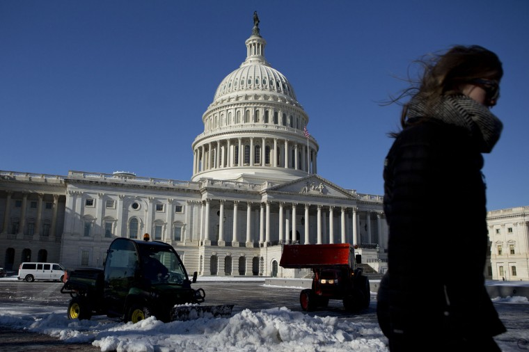 Plows clear snow outside the U.S. Capitol in Washington, D.C., U.S., on Friday, Jan. 3, 2014. A storm along the U.S. East Coast brought snow and wind chills to the region, disrupting travel amid highway closures and thousands of flight cancellations. (Andrew Harrer/Bloomberg)