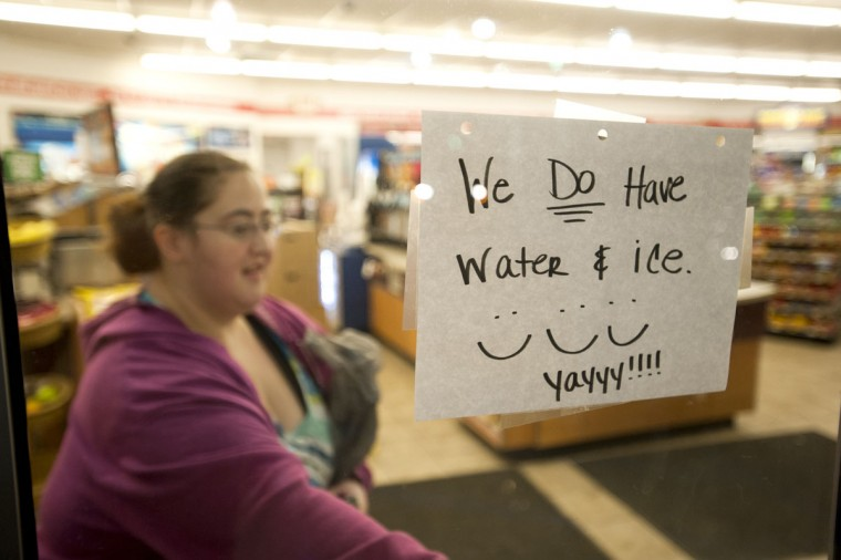 A sign on the entrance of the Speedway announces they have water and ice for sale in Nitro, W.V., on Sunday, January 12, 2014. Water restrictions affecting 300,000 people in nine West Virginia counties continued for a fifth day on Monday following a chemical spill into the Elk River.(Photo for The Washington Post by Ty Wright)
