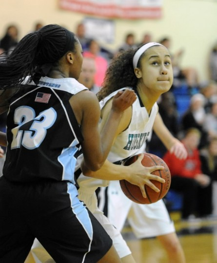 Patterson Mill's Qalea Ismail looks to put up the shot as C. Milton Wright's Alexis Cuffee moves in during Friday night's game at Patterson Mill.