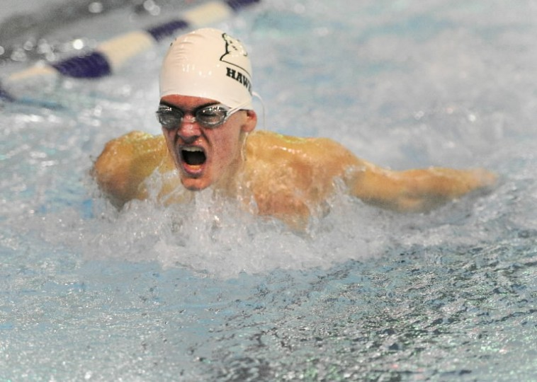 North Harford's Chase Reeves powers through the water in the boys 100-yard butterfly during Wednesday's swim meet with Aberdeen and Patterson Mill at Magnolia Middle School.
