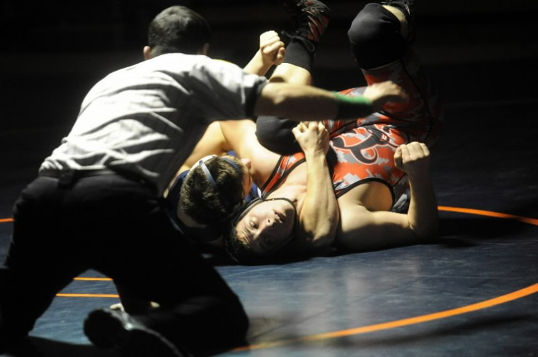 The referee counts for back points as Tyler Scuderi of Glenelg, right, tries to get off his back out of the grasp of Reservoir's Wesley Beattie in the 182-pound weight class match during a wrestling meet at Reservoir High School on Thursday, Jan 9.