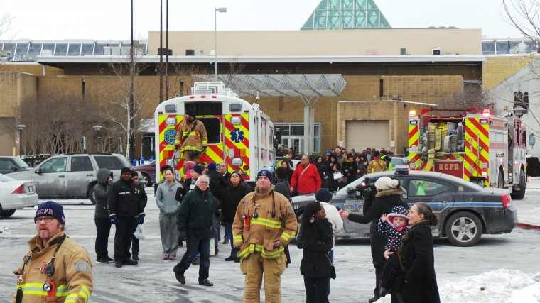 Emergency personnel escort people out from a mall in Columbia