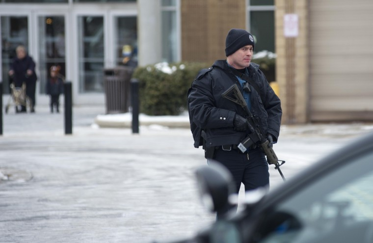 Police on scene during a shooting inside the Columbia Mall Saturday, Jan. 25, 2014. At least three people are confirmed dead, including the shooter, according to news reports claiming police as the source of the information. (Noah Scialom/Freelance)