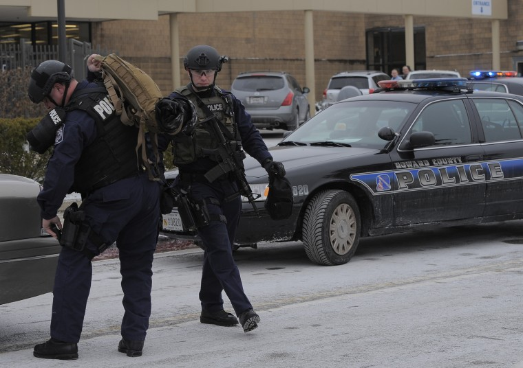 Tactical police gather their gear outside The Mall in Columbia Three people are dead after a shooting Saturday morning on an upper level of the mall. (Kim Hairston/Baltimore Sun Staff)