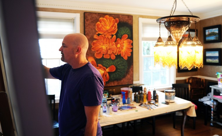 Edward Williams, a Catonsville artist, works on a large commissioned painting of flowers on canvas at his home on Thursday, Jan. 16, 2014. (Jon Sham/BSMG)