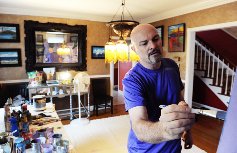 Edward Williams, a Catonsville artist, works on a painting on canvas in his studio at his home on Thursday, Jan. 16, 2014. On his wall behind him are a number of his other works. (Jon Sham/BSMG)