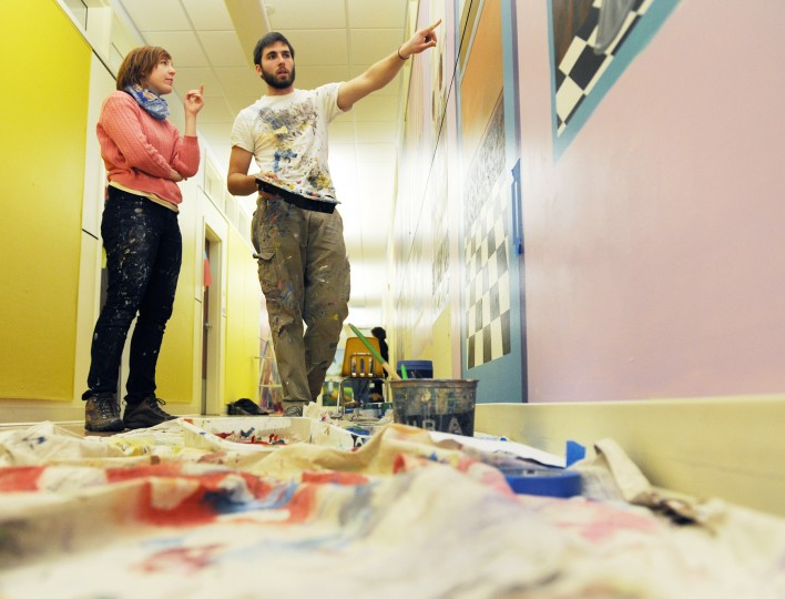 Garrett Ames-Ledbetter, right, of the Aigburth neighbohood in Towson, and Maura Dwyer, of Charles Village, talk about the mural they're working on at the Monarch Academy in Baltimore on Wednesday, Nov. 13, 2013. (Jon Sham/BSMG)