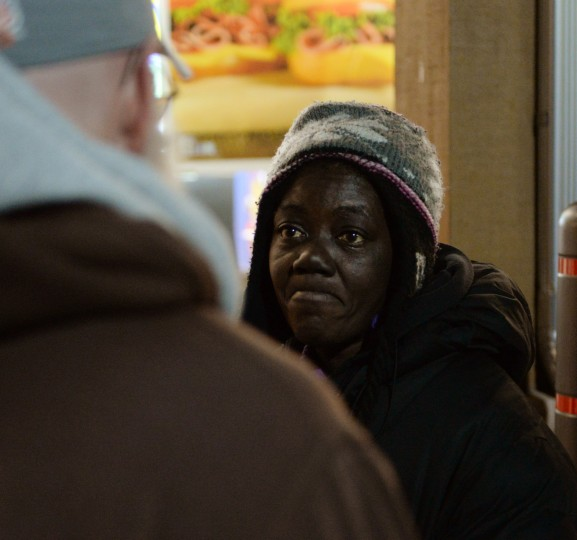 A homeless woman named Belinda asks Rob Williams to buy her something to eat while standing in front of a Royal Farms in Towson. Thursday, Jan. 9, 2014. (Jon Sham/BSMG)
