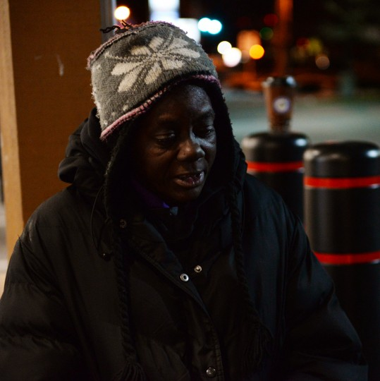 A homeless woman named Belinda stands in front of a Royal Farms store in Towson on Thursday, Jan. 9, 2014, asking passersby how to get on the right bus and if they'll help her get something to eat. (Jon Sham/BSMG)