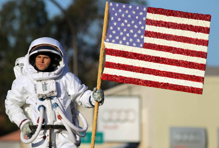 An actor portraying Neil Armstrong walking on the moon is part of the Wells Fargo Opening Show entry in the 125th Rose Parade. (Rick Loomis/Los Angeles Times)