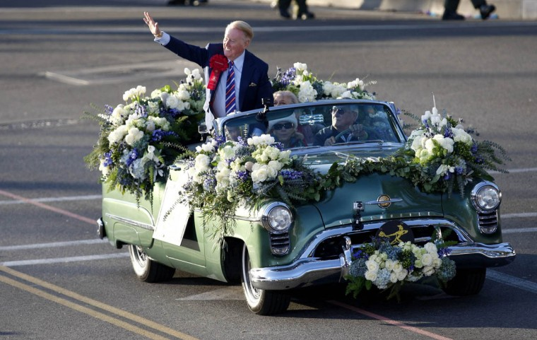 Hall of Fame broadcaster and Rose Parade grand marshall Vin Scully waves to the fans during the 125th Rose Parade. (Allen J. Schaben/Los Angeles Times)