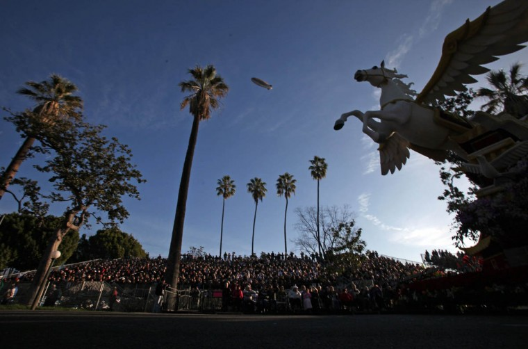"The Singpoli Group ""Connecting Cultures, Delivering Dreams"" float participates in the 125th Rose Parade. (Brian van der Brug/Los Angeles Times)"