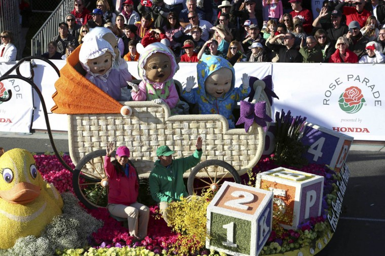 Giant figures of babies in a stroller adorn part of the Kaiser Permanente float. (Jonathan Alcorn/Reuters photo)