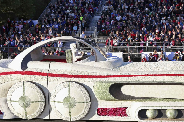 "A section of the American Honda float passes a grandstand at the 125th Rose Parade. The 2014 Rose Parade, themed ""Dreams Come True"", features florally decorated floats, marching bands, and equestrian units on a five and a half mile parade route through Pasadena. (Jonathan Alcorn/Reuters photo)"